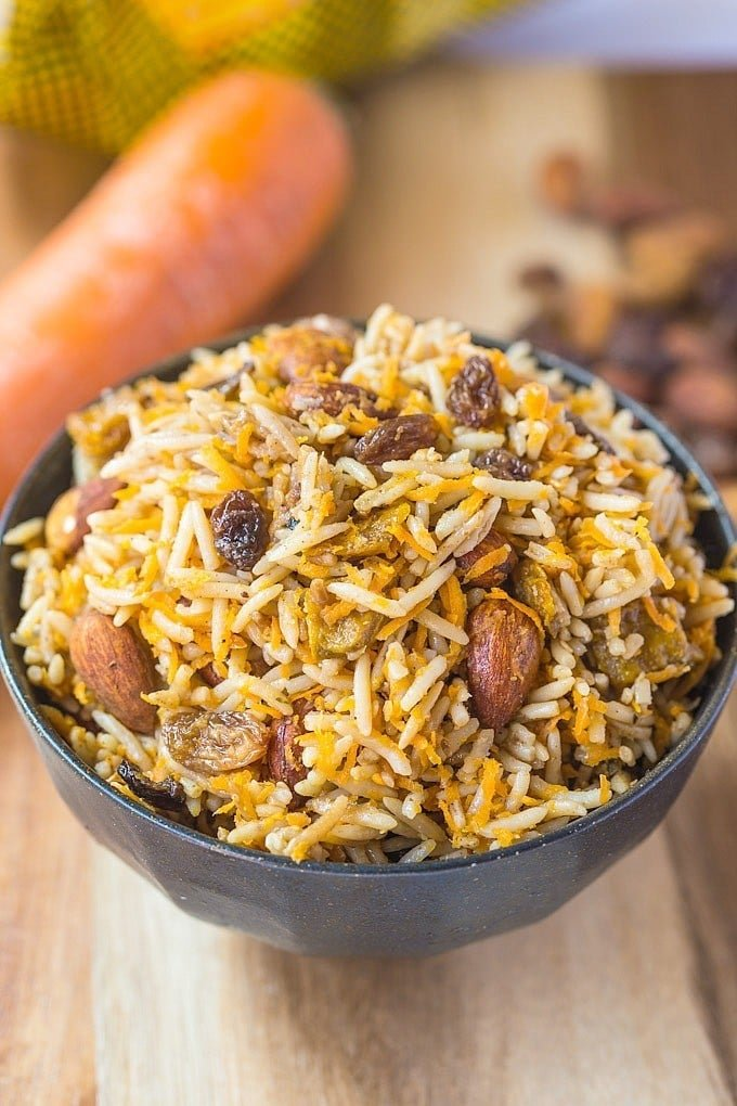 Vegan Persian Rice Salad- A delicious, Persian style sweet and savoury salad based off almonds, raisins and fragrant basmati rice. Perfect eaten hot or cold, this salad is vegan, gluten free, dairy free, light and fresh- Perfect for any meal, especially a mother's day brunch! @thebigmansworld - thebigmansworld.com