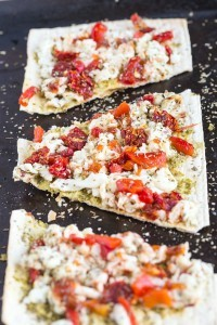 Creamy Egg White and Pesto Breakfast Pizza- Healthy and chock full of protein, this is a delicious savoury breakfast or snack to enjoy!