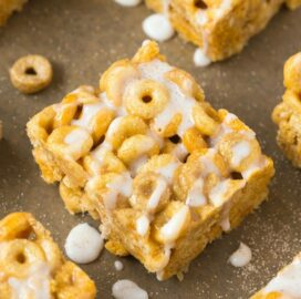 Cinnamon roll protein cereal bars topped with cinnamon drizzle