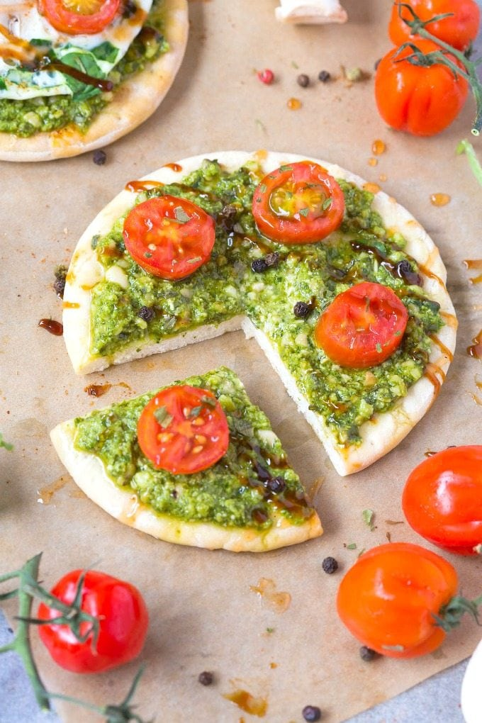 Healthy Low Carb Breakfast Pizza slices topped with pesto and balsamic