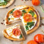 low carb pizza crusts topped with sauce and pesto