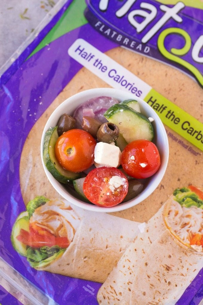 Healthy Greek Salad Wraps- Creamy feta mixed with fresh salad vegetables all wrapped up for the perfect lunch or dinner- Filling, low calorie and 6 weight watchers pro-points plus! {gluten free, low calorie, high protein recipe}- thebigmansworld.com