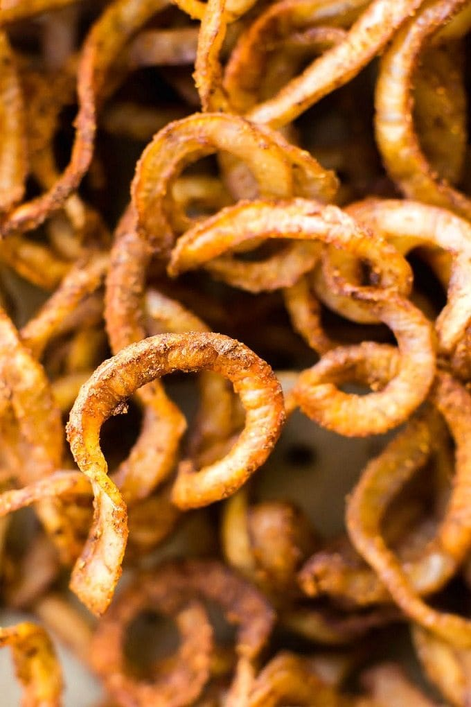 Healthy Oil-Free Baked Curly Fries (Whole30, V, GF, P)- Easy, fat-free potatoes which are crispy, easy and the perfect spice blend- The perfect snack or vegetable side dish! {vegan, gluten free, paleo recipe}=thebigmansworld.com