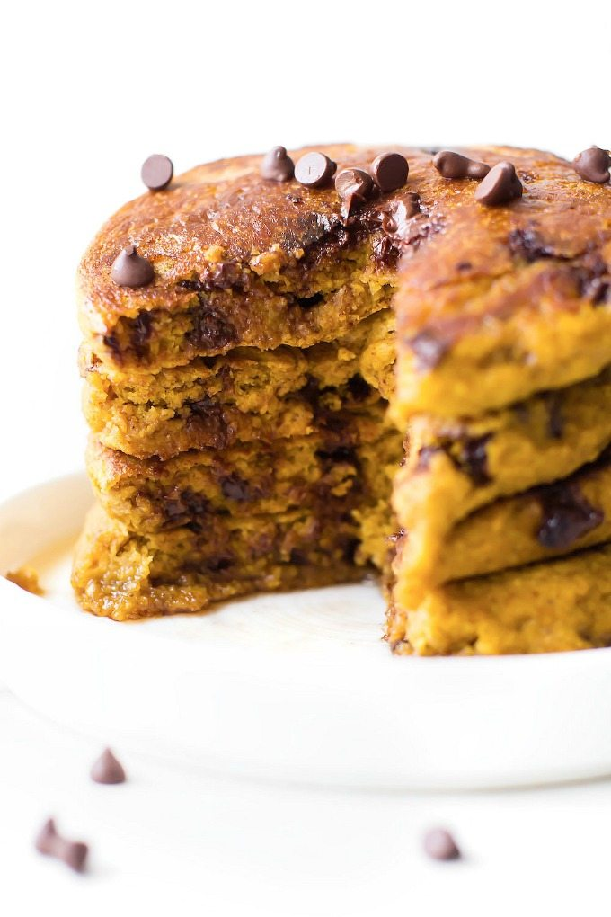 Fluffy Flourless Pumpkin Pancakes (V, GF, SF)- Thick, fluffy and pillow-like pumpkin pancake recipe- Made with NO eggs and NO flour but you'd never tell- Freezer friendly too! {vegan, gluten free, sugar free recipe}- thebigmansworld.com