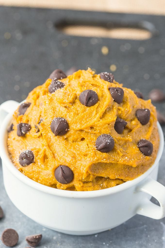 Healthy Paleo Vegan Pumpkin Cookie Dough in a white bowl, topped with chocolate chips