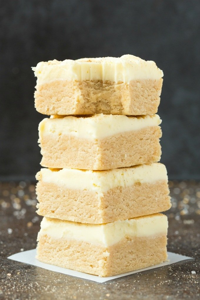 Easy No Bake Paleo Vegan Cinnamon Roll Protein Bars stacked on top of one another.