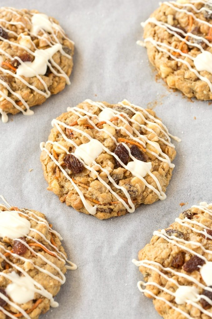 A cookie sheet with flourless carrot cake oatmeal cookies on it.