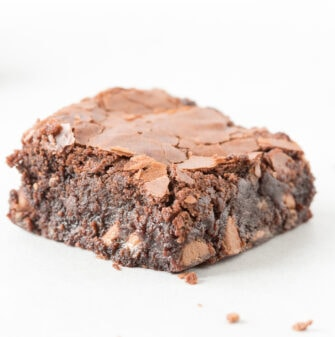 Brownies made with almond flour and stevia that are thick, gooey and tender on the outside- the best keto and vegan dessert!